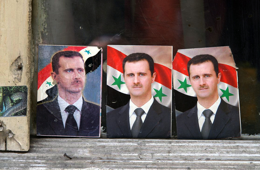 Bashar al-Assad portraits in a window, Damascus, Syria