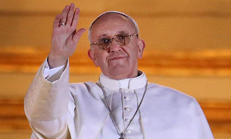 The newly elected Pope Francis I waves to the crowds from St Peter's basilica.
