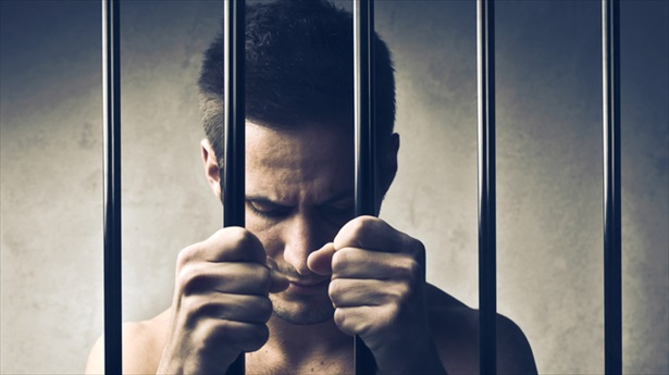 Young-man-in-jail-Shutterstock