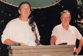 George W. and George H. W. Bush in a photo taken at the Bohemian Grove.