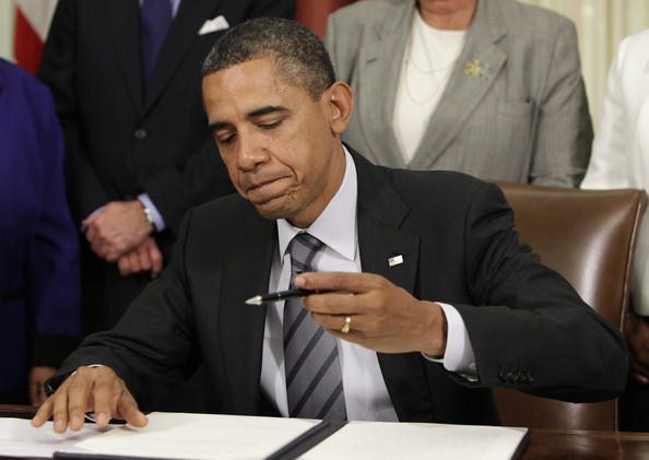 http://www.dcclothesline.com/wp-content/uploads/2014/03/Obama-Signs-Executive-Order.jpg