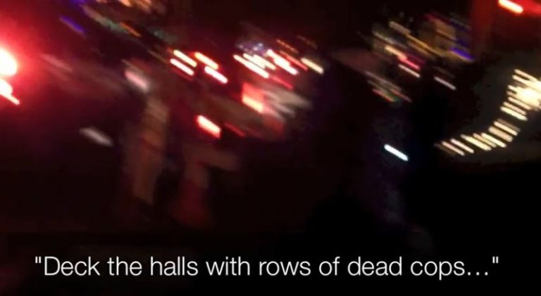 "Ferguson Protesters Sing ""Deck The Halls With Rows of Dead Cops"""