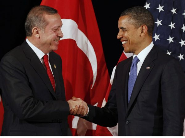 U.S. President Obama shakes hands with Turkey's PM Erdogan after a bilateral meeting in Seoul