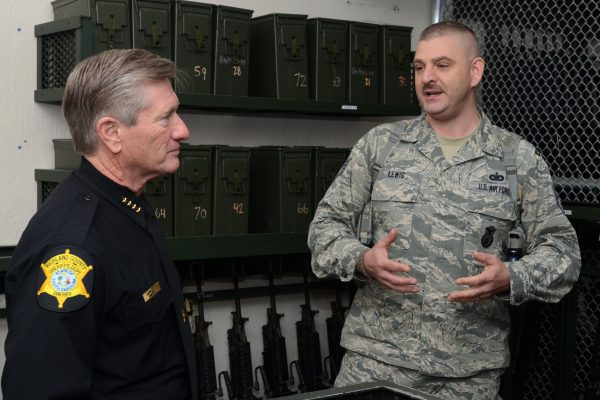 "U.S. Air Force Lt. Col. Paul Laymon, the Defense Force Commander for the 169th Security Forces Squadron, and Staff Sgt. Kenvyn Lewis, combat arms trainer for the 169th SFS, give Sheriff Leon Lott, from the Richland County Sheriff's Department, a tour of the unit's armory and weapons arsenal. Sheriff Lott received the title as ""Honorary Defense Force Commander"" for the South Carolina Air National Guard's 169th Security Forces Squadron during a ceremony held at McEntire Joint National Guard Base, S.C., Nov. 1, 2014. This honor recognized Sheriff Lott as a community leader and supporter of the South Carolina Air National Guard to strengthen community relationships and share in team building training and experience. (U.S. Air National Guard photo by Senior Master Sgt. Edward Snyder/Released)"