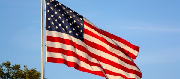 American-Flag-Flying-1263x560