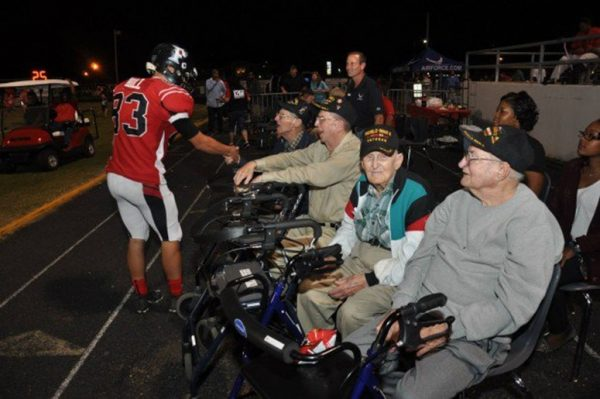 When This High School Football Player Sees US Veterans in the Crowd, He Brings the Game to a Standstill