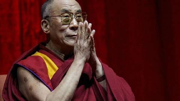 The Dalai Lama Just Told the World to Stop Praying for Paris