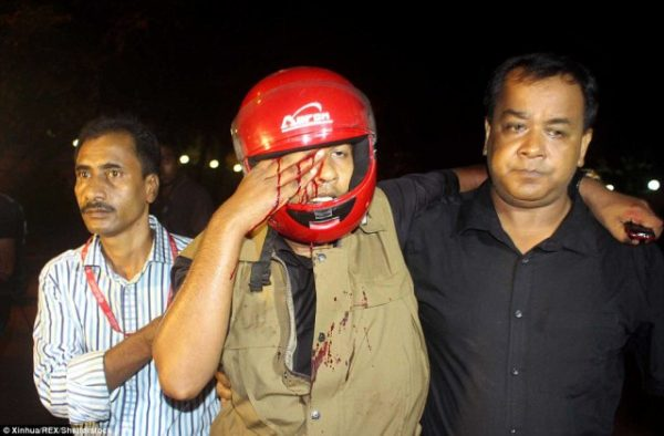 35E0806300000578-3671369-An_injured_policeman_is_carried_away_after_the_attack_in_Dhaka_o-a-45_1467473268737