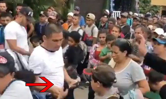 VIDEO: Someone is Handing Out Stacks of Cash to the Migrants Headed to U.S.