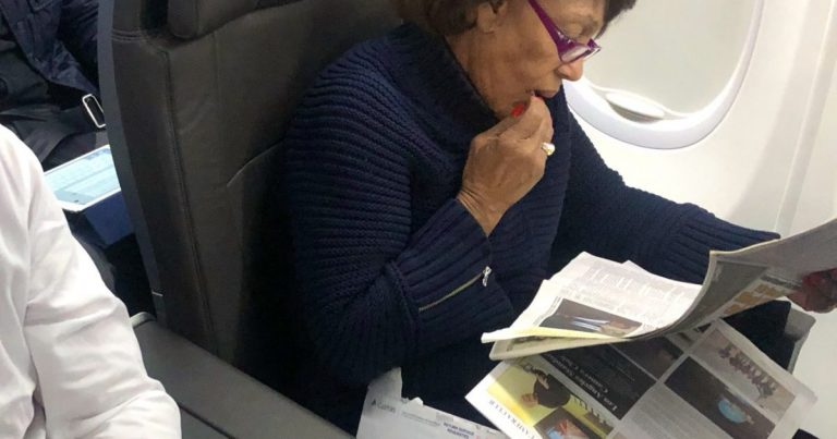 While Federal Employees Are Without A Pay Check, Photos Capture Rep. Maxine Waters In First Class Reading About Herself