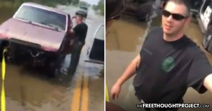 VIDEO: Oklahoma Cop Caught Harassing & Fining Flood Victims for Trying to Help Each Other