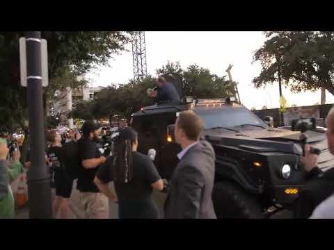 Alex Jones bullhorns Dallas Trump rally from armored vehicle