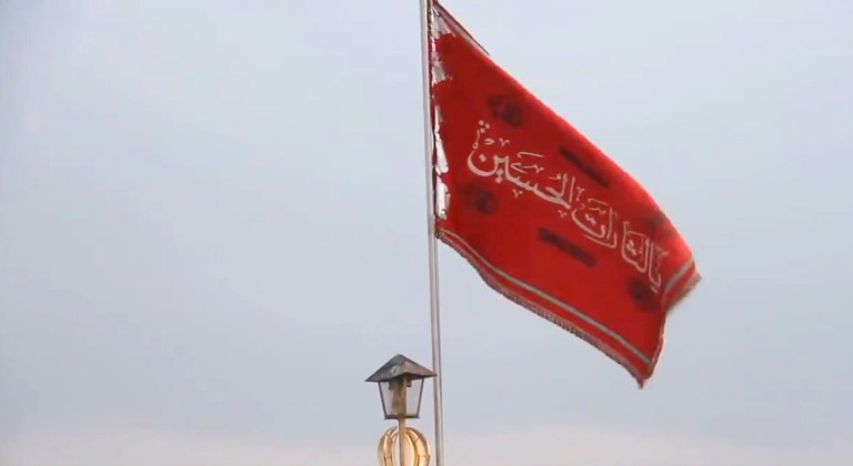 Why is Iran Flying a Blood Red Flag Over a Famous Mosque?