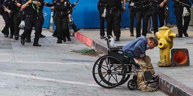 Sadistic Riot Cops Shoot Innocent Wheelchair-Bound Homeless Man in the Head