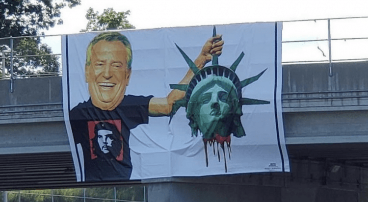 NYC Banner Shows Commie De Blasio Holding Lady Liberty's Severed Head