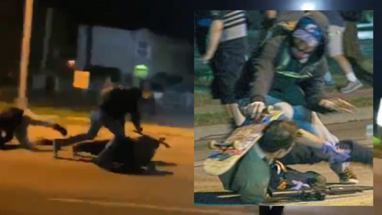 FIGHT for your LIFE: Stunning video shows moment armed security man had to shoot multiple rioters from the ground or be beaten to death by Black Lives Matter thugs