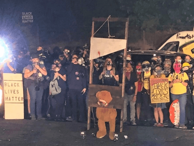 """BLOOD in the streets: Left-wing Portland rioters display bloody guillotine as they burn American flags; new Democrat logo says """"Death to America"""""""