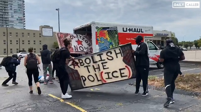 WATCH: U-Haul Truck Pulls Up With Shields, Signs & Supplies For Antifa & BLM Rioters in Louisville