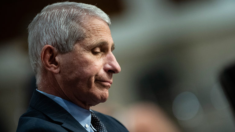"Fauci the fraud pretends to have soreness in right arm after getting ""vaccinated"" in left arm"